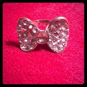 Pink and white bow ring .